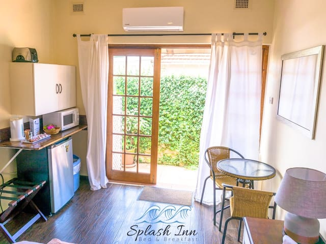 Private entrance with breakfast nook, bar fridge, microwave, kettle and toaster