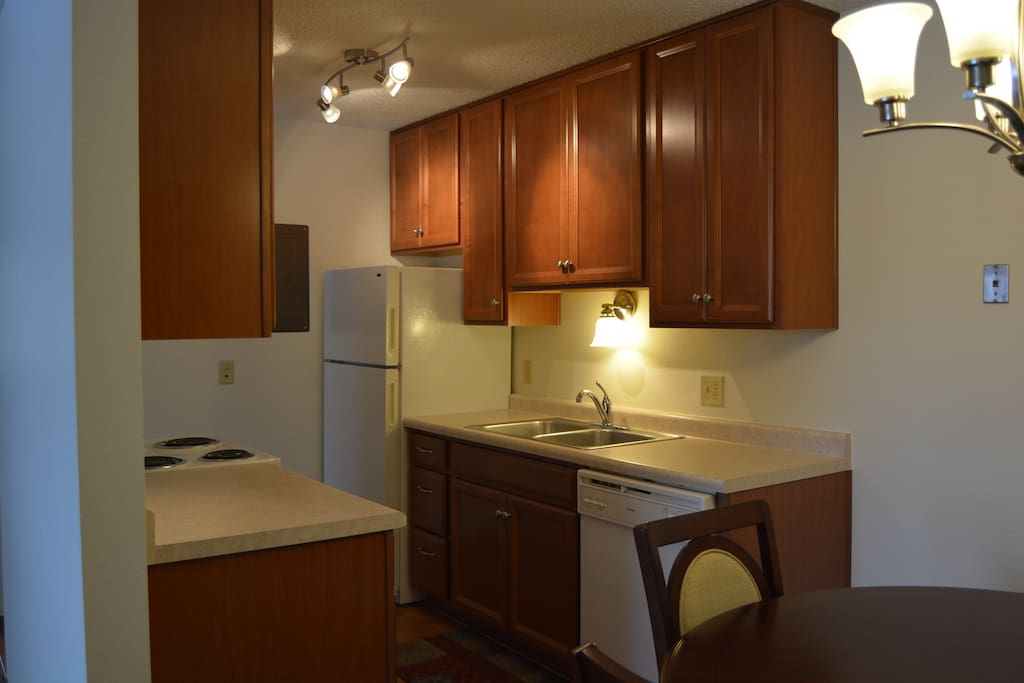 The fully equipped kitchen lets you fix a quick meal or a dinner for friends or family.