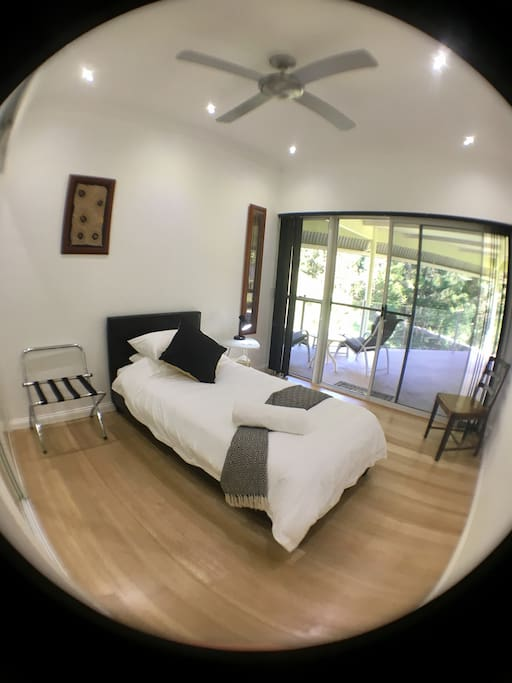 PRIVATE SINGLE ROOM has high ceilings and State of the Art Ceiling Fan, plus the latest dimmer lighting.  Access onto HUGE UNDERCOVER BALCONY with Mountain Views, tables and Chairs for you to RELAX!