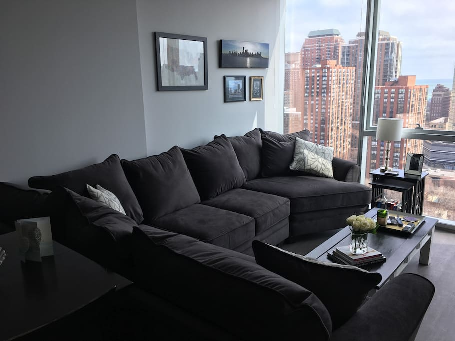 Floor to ceiling windows w/ lake views throughout, sectional couch