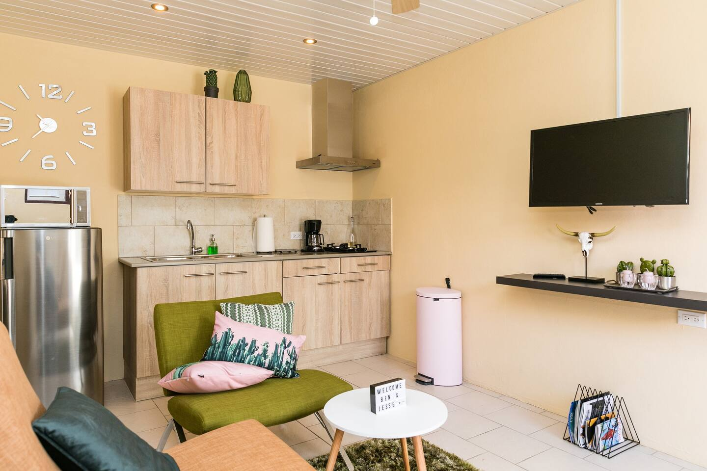 """Immaculate space  """"Mondi"""" themed cozy sitting room and open kitchen"""