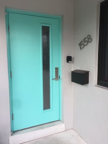 Our front door with lock box for lux studio to right of the door for access if we are not home to greet you.