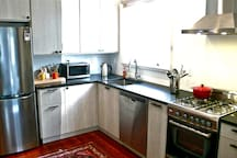 Full kitchen has everything you need to cook a meal - or heat your NOLA restaurant leftovers :)