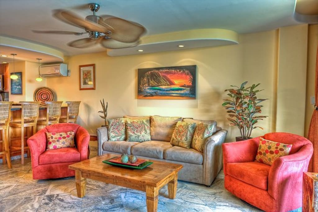 The living room.  Note the travertine floor and the original Hawaiian Giclee.