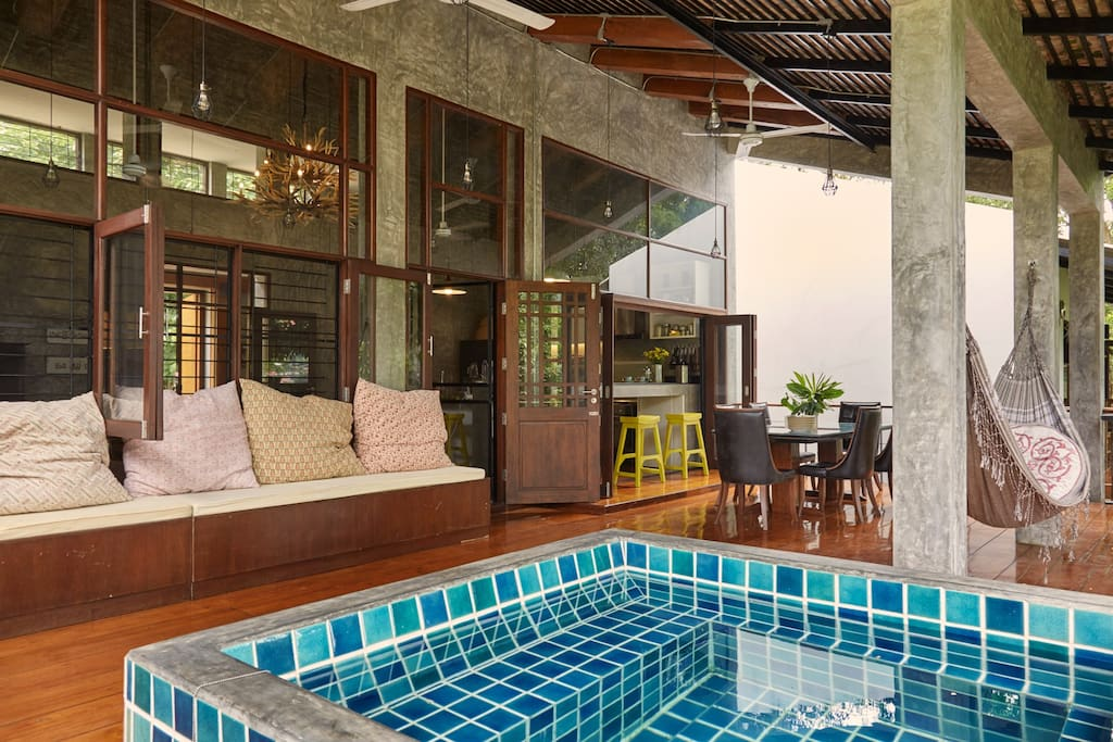 Lovely balcony with hammock, dining area and plunge puddle.