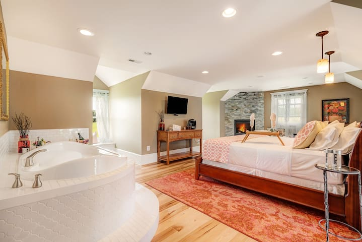 Enjoy a relaxing cocktail fireside or in your own private in room jacuzzi in the Longfellow Loft Suite.