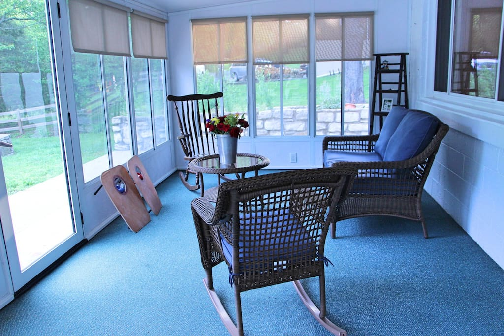 Enjoy a quiet morning before a busy day in the serenity of the sunroom. Or try a game of cornhole in the back yard with the set provided!