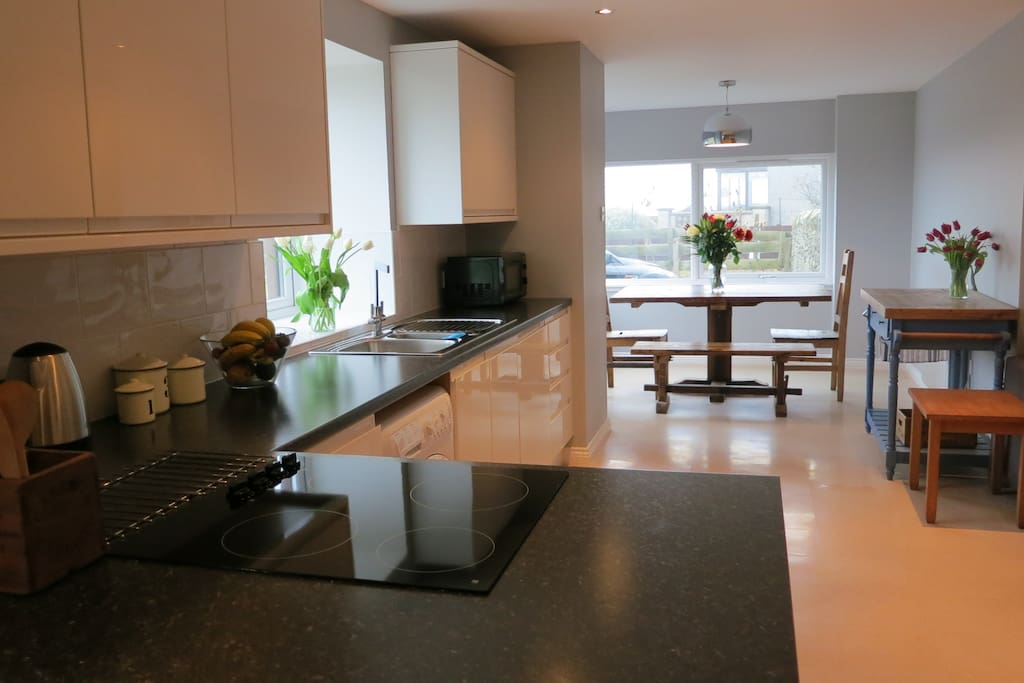 Kitchen with dinner table with view to sea - easy to spot dolphins!
