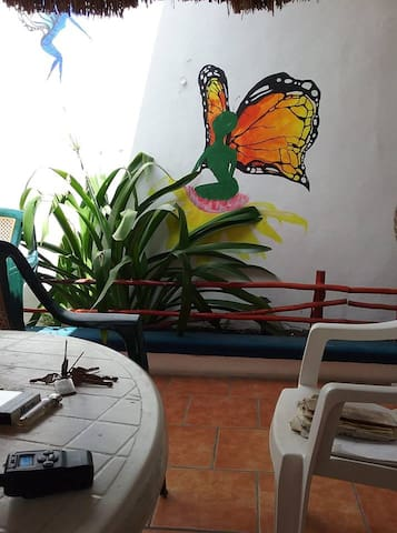 alien butterfly mural in the front patio area.  Mural by artist Don Tucker