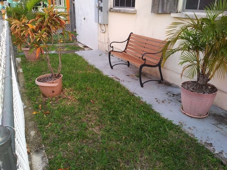 Sit an enjoy the sights and sounds of this typical Barbadian neighbourhood