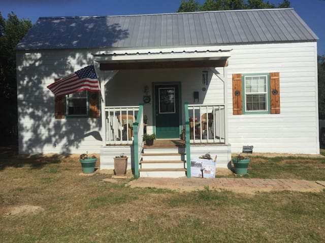 Tiny House in the little town of Bailey, Texas. Over 100 years old, fully renovated. Front and back porches, covered parking. This labor of love is now ready for you to come and unwind and enjoy the small time life in a small tiny place.