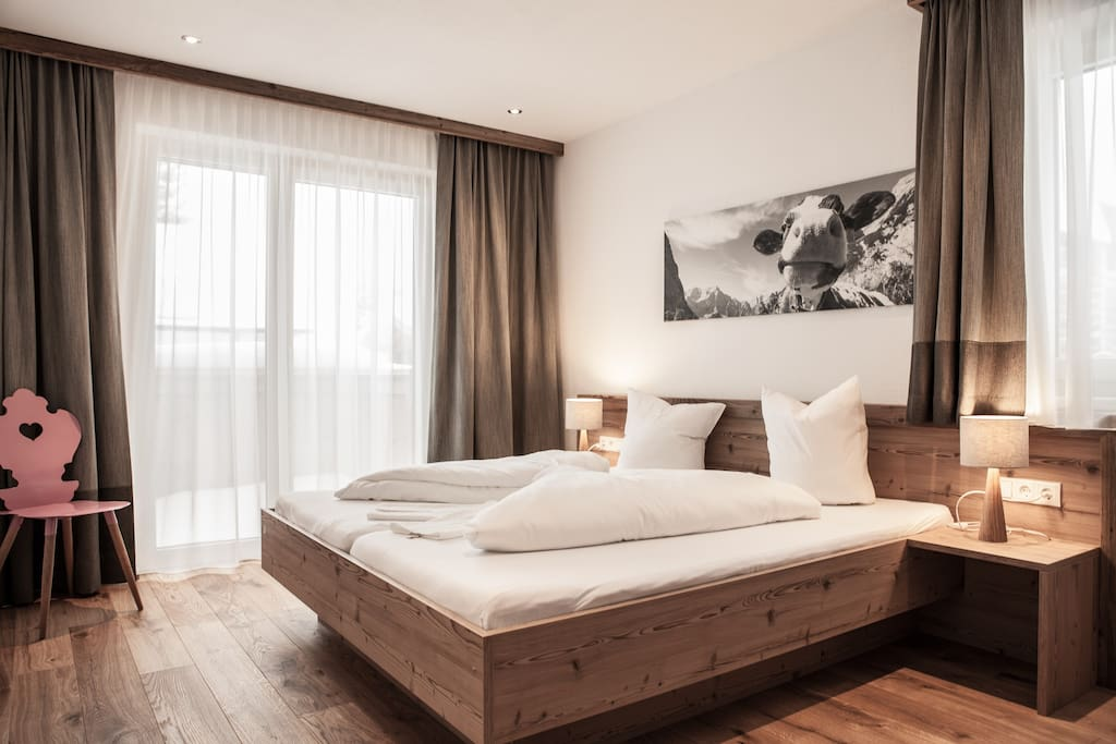 2 spacious en-suite bedrooms with direct access to terrace