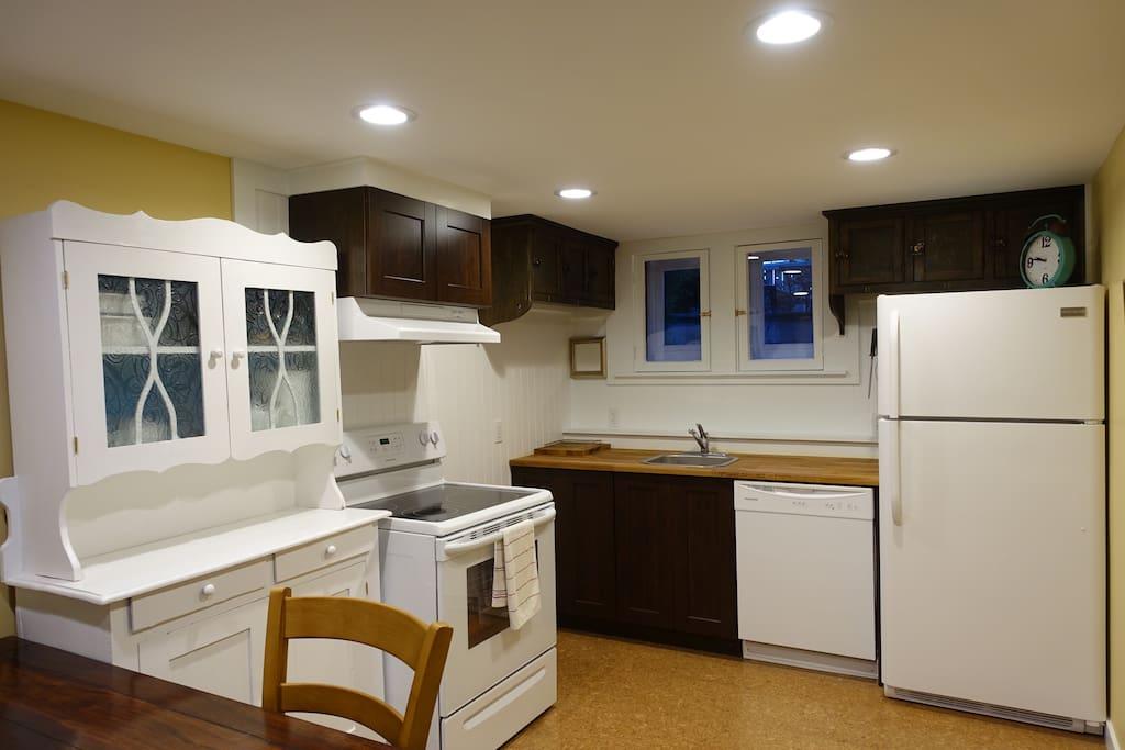 Bright, cheerful, windows and plenty of storage, full sized kitchen (fridge, d/w, stove).