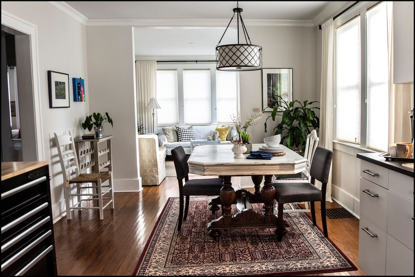 Open concept living, dining and kitchen is flooded with light and loaded with charm.  Original oak hardwood floors. Comfortable furniture everywhere.