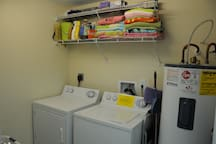 Laundry Room with New Samsung Large Capacity Washing Machine and Dryer