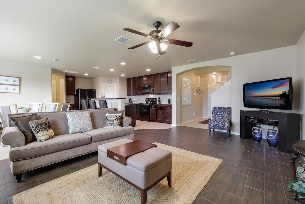 Beautiful open-format family room, dining and kitchen.