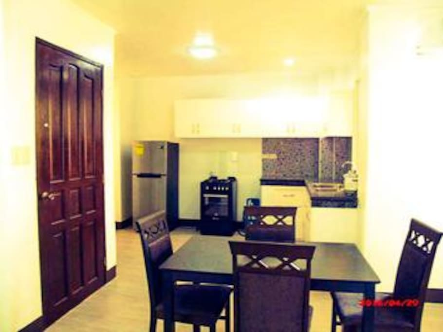 dining area, kitchen with full size fridge and stove with oven. granite counters in all!