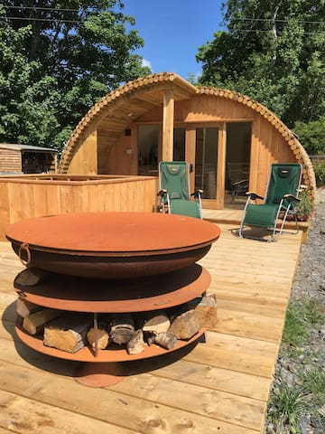 Large decking area with fire pit and hot tub