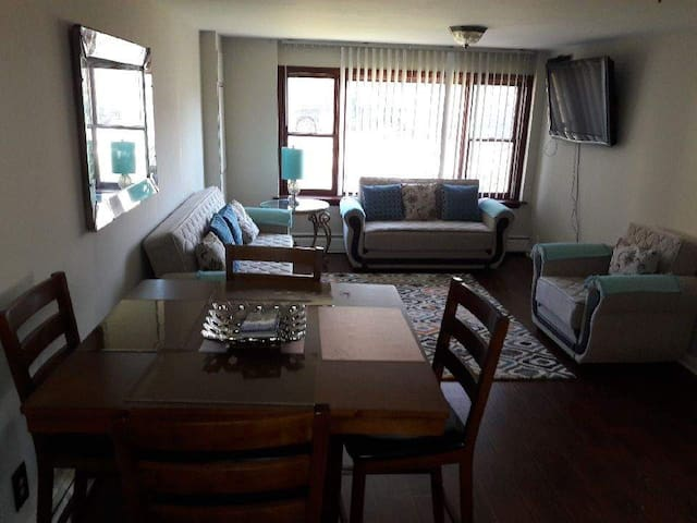 Living room with dining table and television