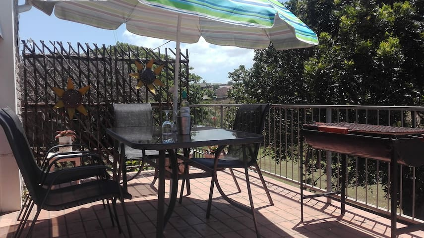 Private Balcony with braai facilities as well as beautiful nature and sea views.