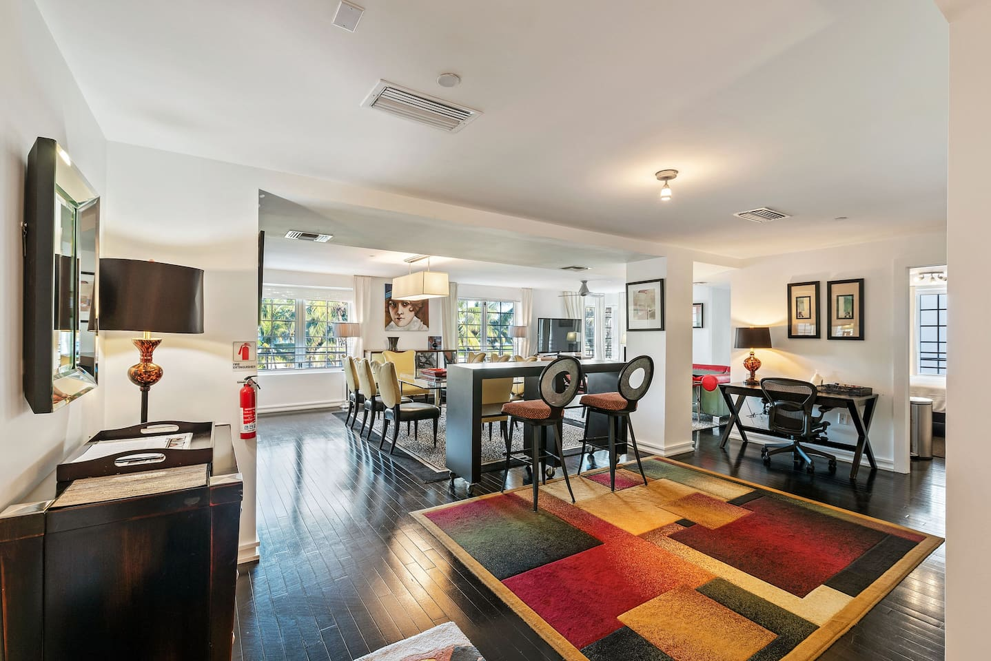 You walk into this spacious, elegant apartment, gaze out of the five windows looking out at Ocean Drive and the beach, and know that you have chosen well.   This is what you see when you walk into the door.