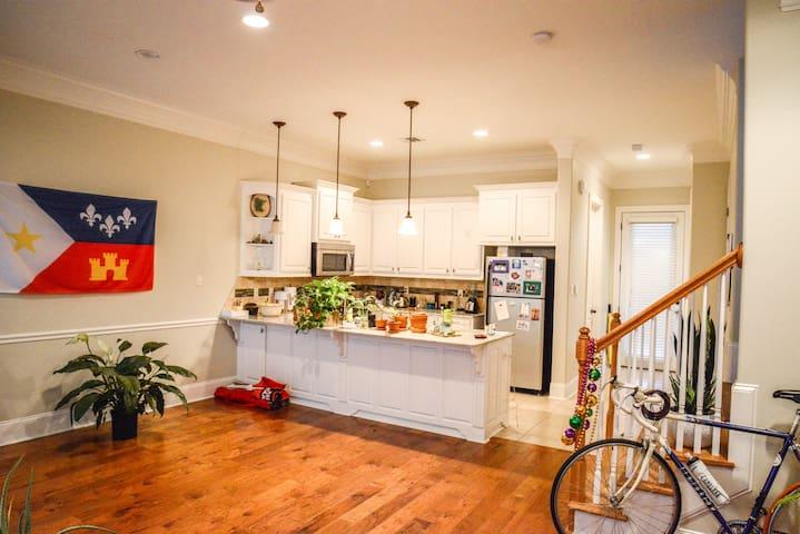 Open floor plan kitchen/Community space/Entrance/Stairway