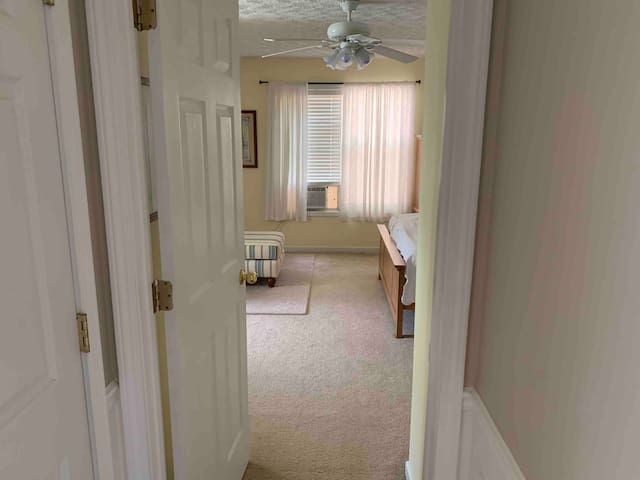 View into single room to rent. Window unit for your added comfort to compliment the whole house AC.
