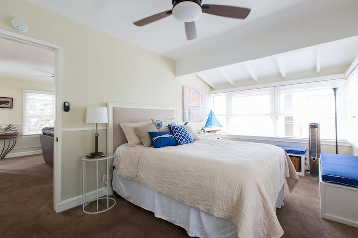 The bedroom has a Queen size bed with plenty of pillows/extra bed sheets and a smart TV connected to Wifi.