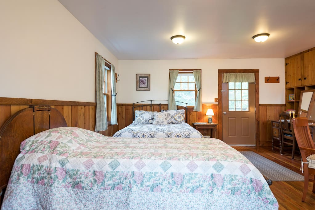 Inside the Horse Barn Apartment, there is a queen bed and a single bed.