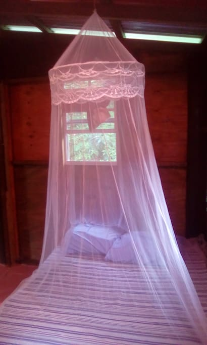 BED WITH MOSQUITO NET,BREADFRUIT ROOM