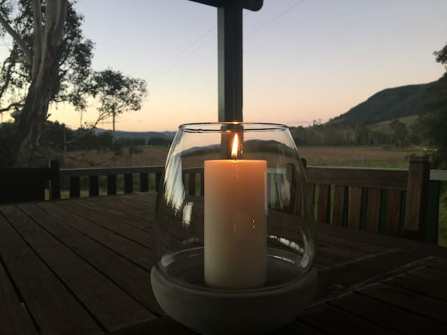 Candlelight and sunset on the covered veranda