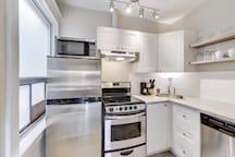 Modern kitchen including automatic dishwasher.