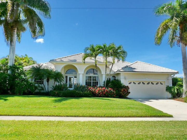 Beautifully maintained, waterfront home w/ spacious, heated pool