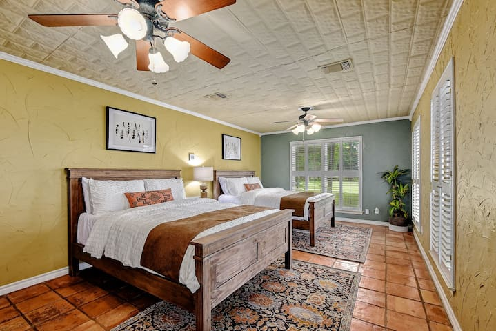 The only bedroom located on the first floor features two traditional reclaimed pine queen size beds.