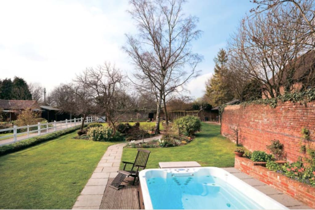 SwimSpa and walled private garden