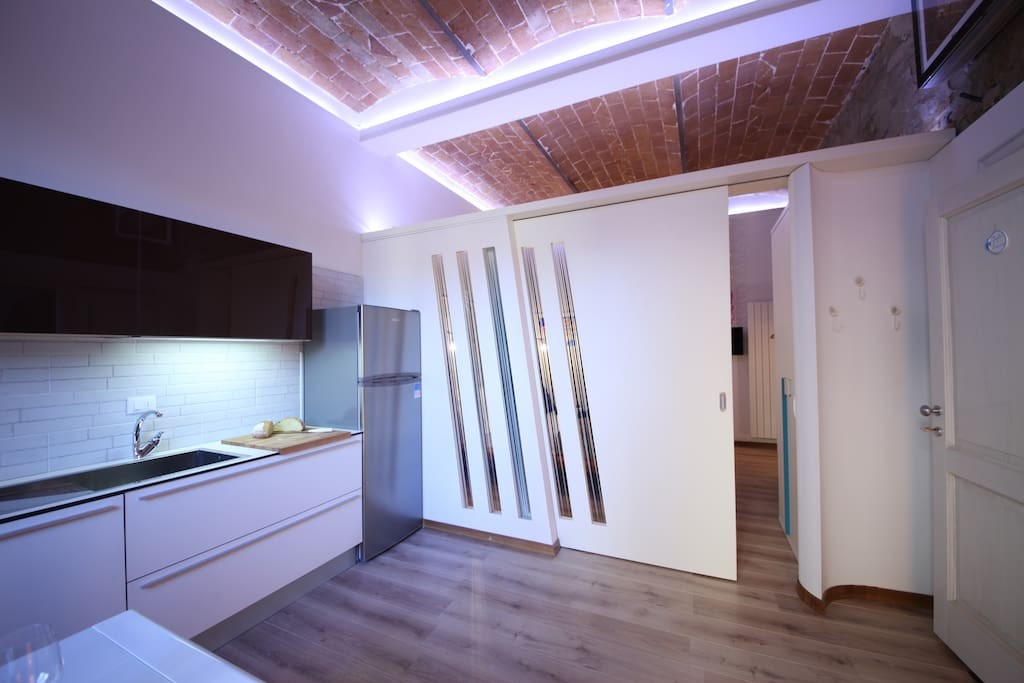 kitchen separated from double bedroom