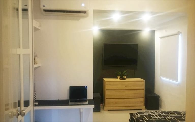 Master Bedroom with 50in Cable TV and Air Conditioning