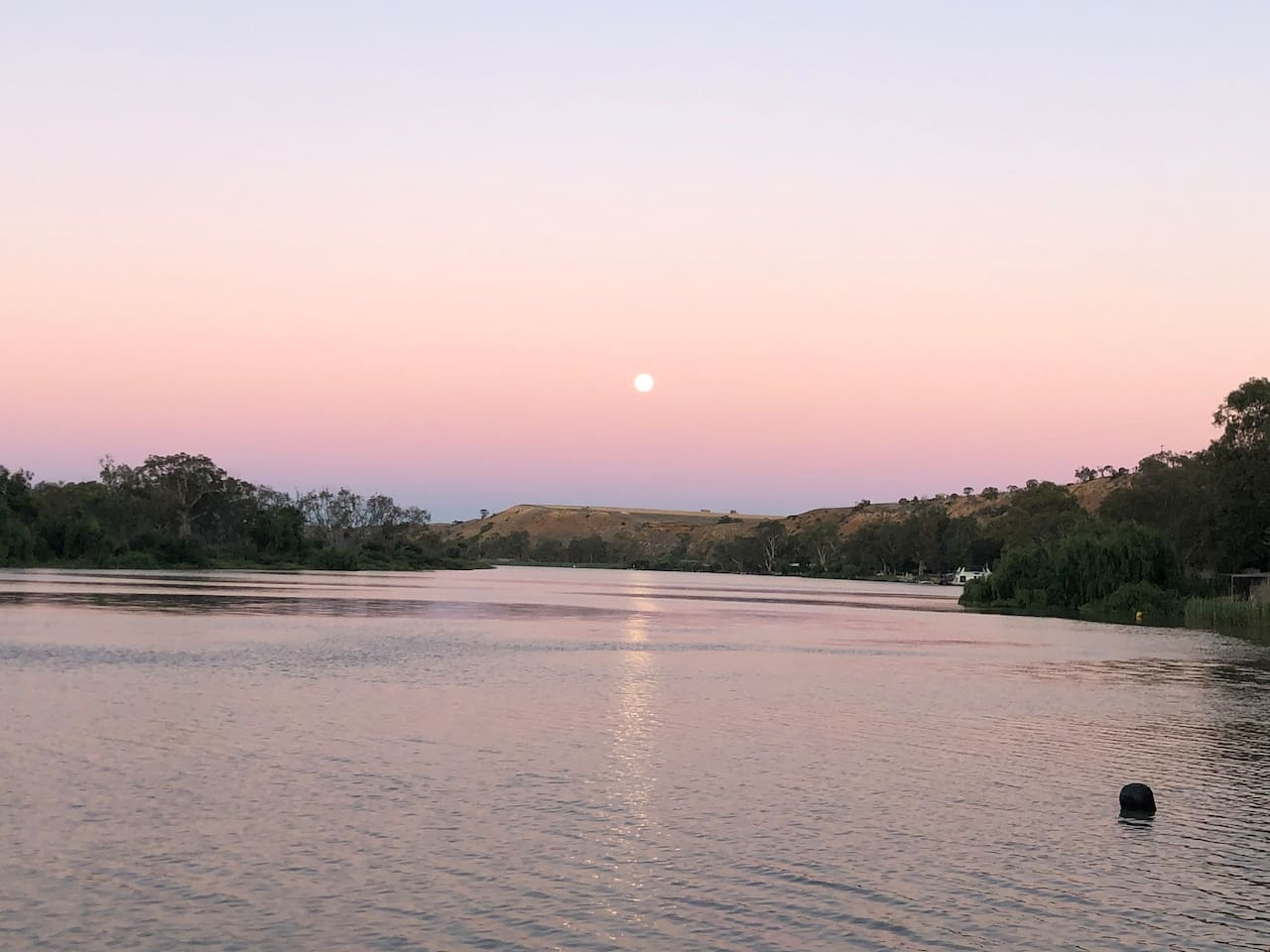 Moonrise at sunset from your jetty on absolute riverfront.