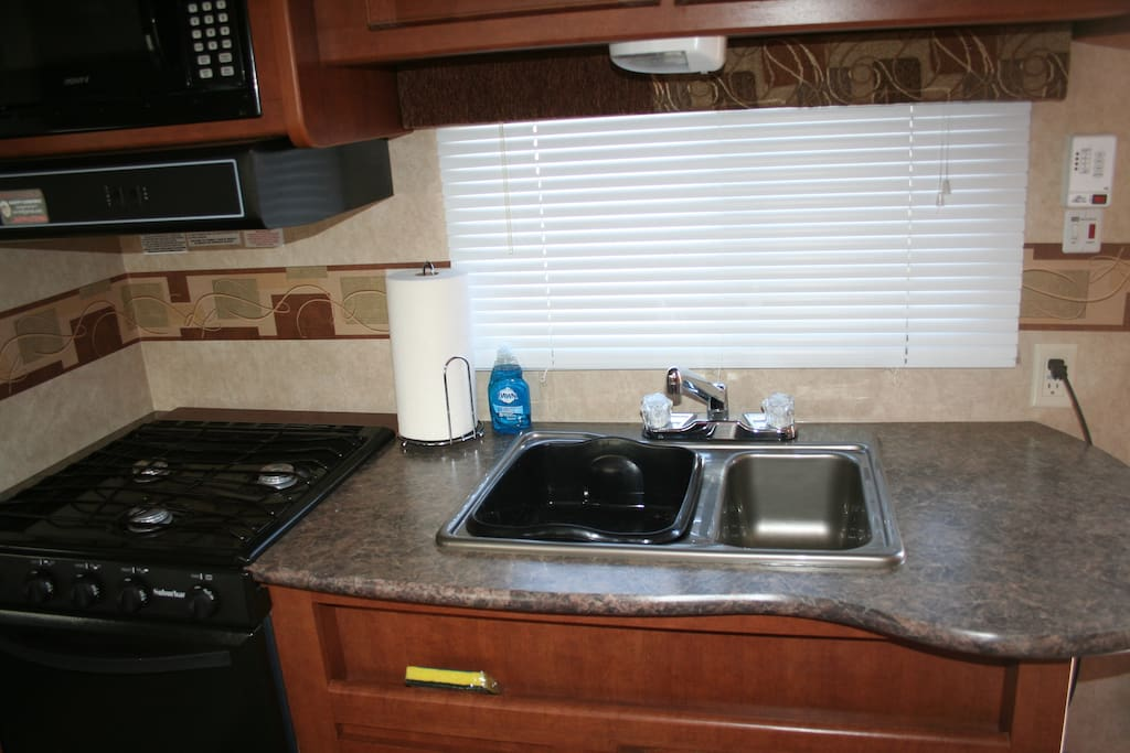 Our trailer comes with a stove, sink, refrigerator, oven