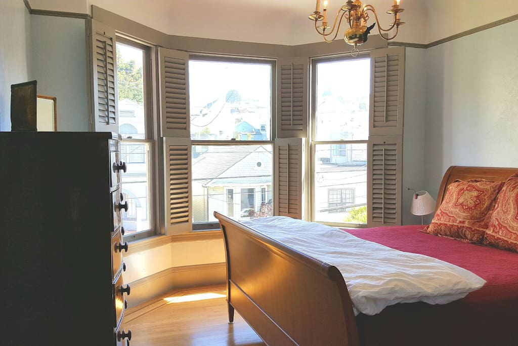 Large bedroom with king bed and bay window