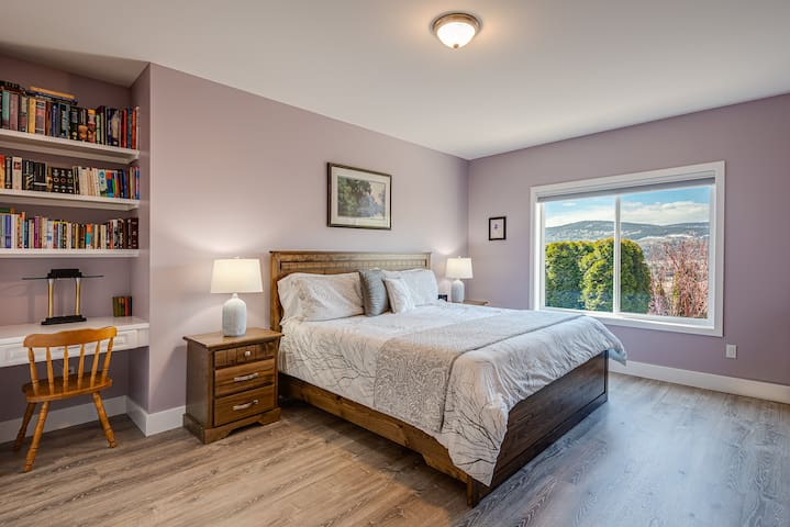 Lavender King Bedroom with a private washroom.