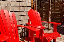 Soak up the sun , read a book or  just relax in the comfortable Adirondack chairs