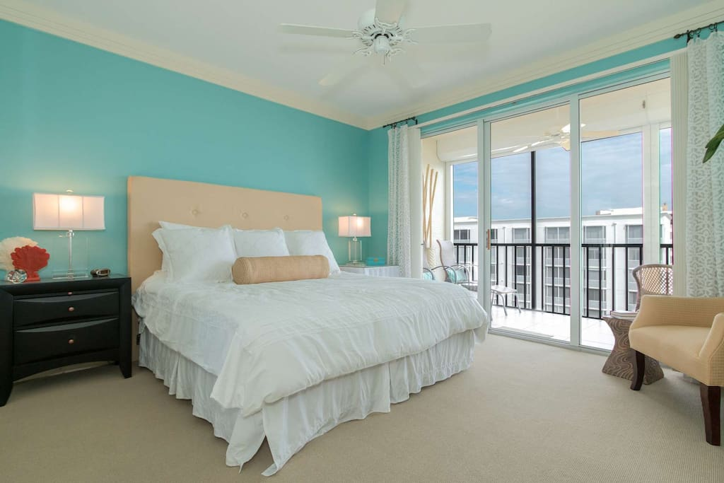 You will enjoy waking up in the elegant master suite, with king size bed, and private access to the screen enclosed balcony.