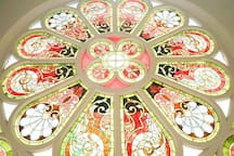 Beautiful view of the stained glass windows that were preserved from the original building!