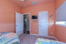 The third bedroom has cute decor and two twin beds