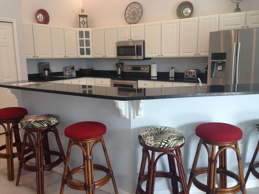 Granite counter in kitchen with stainless steel appliances
