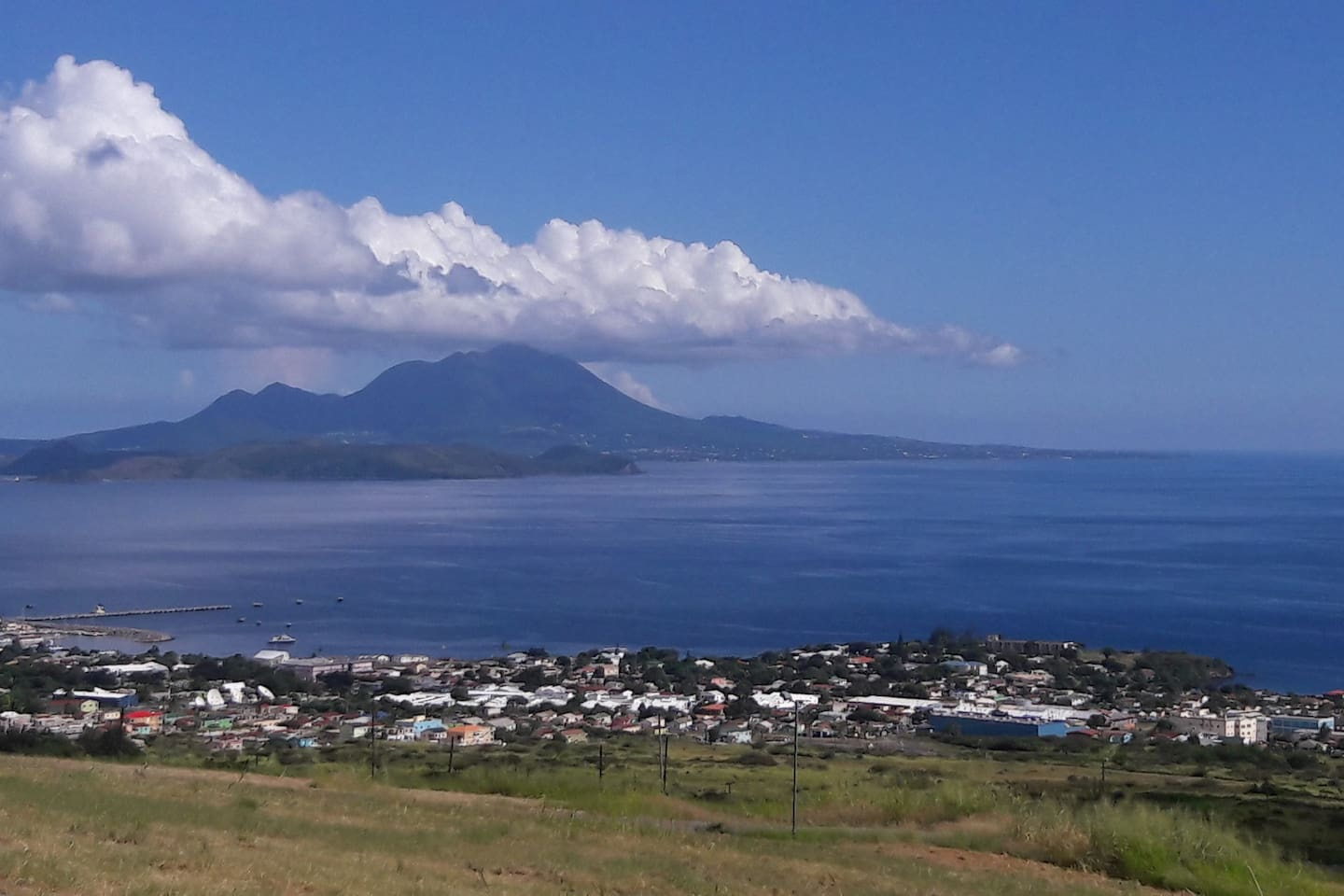 Ocean View - Take a peaceful walk in  the community and enjoy this panoramic view of Basseterre and Nevis in the distance.