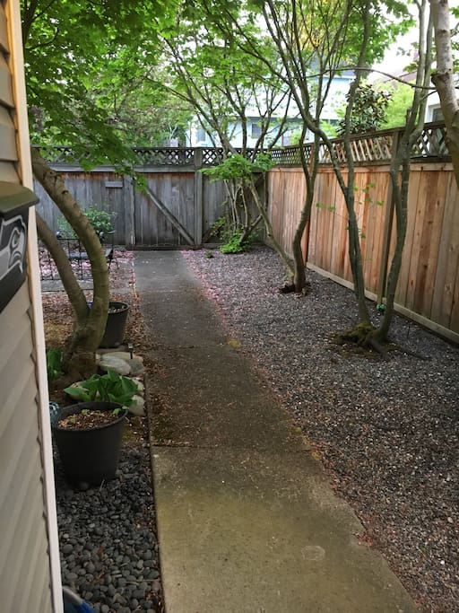 Enclosed private yard with outdoor seating area in quiet Ballard.