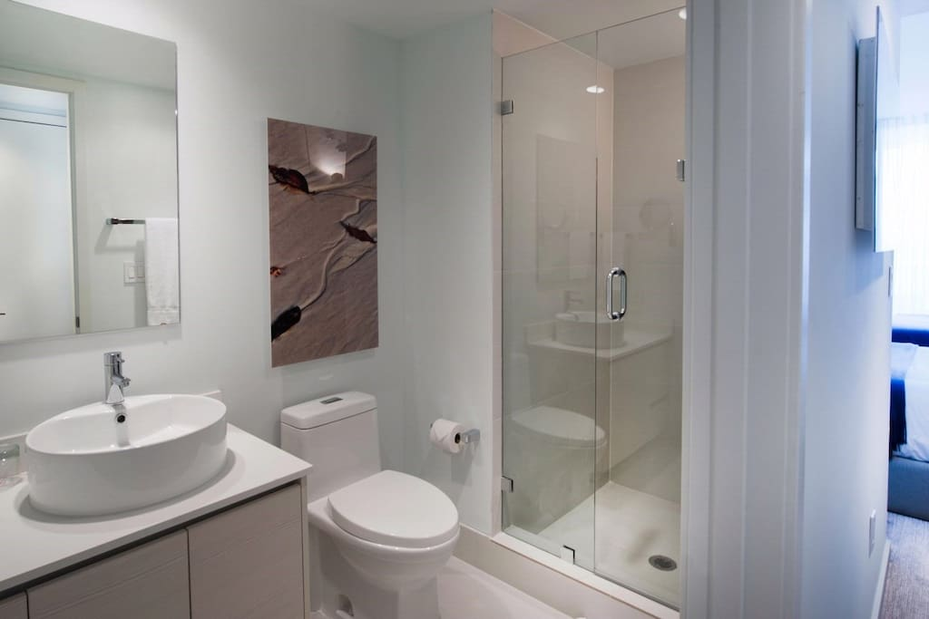 Get ready for the day ahead in the spacious and modern deluxe bathroom.