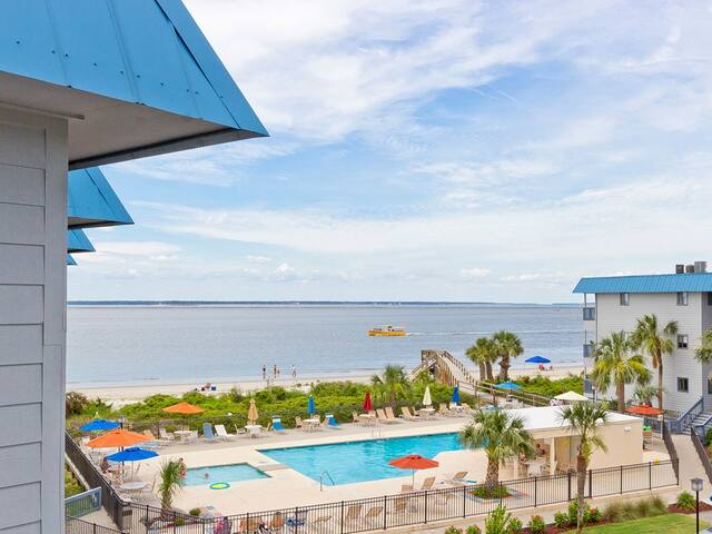 Top Floor Corner Unit with Beautiful Water View of the Bay and Community Pool - Beach Racquet B320